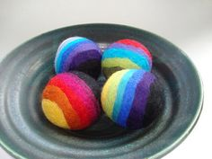 Felted Wool balls - rainbow stripes  set of 4 by NutmegNaturalsCT.  Great child toys, stress balls, and home decor!