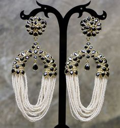 This Bollywood style Indian earring set is crafted by Indian artisans and is gold plated. Stunning Ring Style Drop Down Pearl Black Earring Set. A great way to accessorize and add style to any outfit. Indian Earrings, Black Earrings, Gold Plated Earrings, Stone Earrings, Pearl Earrings, Drop Earrings, Bollywood Style, Bollywood Fashion, Stunning Eyes
