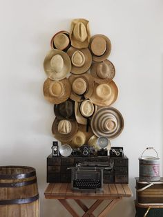 U: Unusual Collection Flea market hats hung on plastic hooks in the living room look great as wall art.