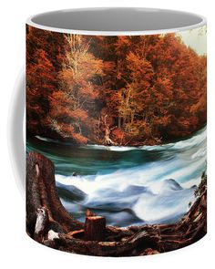 Coffee mug featuring a view of Manso River at the Nahuel Huapi National Park in San Carlos de Bariloche in the province of Rio Negro, Argentina. Autumn, orange colors and water flowing. Our ceramic coffee mugs are available in two sizes: 11 oz. and 15 oz. Each mug is dishwasher and microwave safe. Worldwide shipping within 1 - 2 business days. Click through to get yours! Art for your life by Eduardo Jose Accorinti.