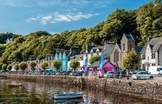 Tobermory, Scotland~ You may recognize the bonny Scottish fishing hub as the town from the classic UK children's TV show Balamory. The pretty port is home to the less kid-friendly Tobermory Distillery which, at the head of the bay, mainly produces a matured single malt whisky. The tiny town is also shrouded in mystery. According to legend, a gold-laden Spanish galleon ship lies undiscovered beneath the mud of the bay. Spanish Galleon, Top Destinations, World's Most Beautiful, Countries Of The World, World Heritage Sites, Small Towns, Kayaking, Scotland Uk, Explore
