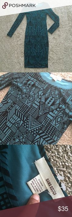 Gorgeous Aztec Print Dress   brand: sans souci  size: small  fits true to size  color: dark green and black never worn, just sitting on a hanger in my closet  long sleeve  this beautiful dress goes beyond the knee  it's a tight fitting dress 10/10 condition  no flaws  make an offer using the offer button  price is always negotiable   (I can not model this item. I can no longer fit into this dress) Sans Souci Dresses Long Sleeve