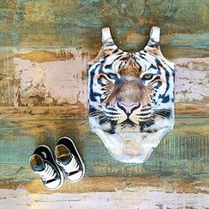 NEW • Popupshop tiger swimsuits have arrived! Styled with Converse high top Chucks, all available at Tiny Style in Noosa & online • www.tinystyle.com.au/Shop-Insta