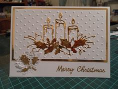Christmas card using Memory box glowing candles die and Holly punch