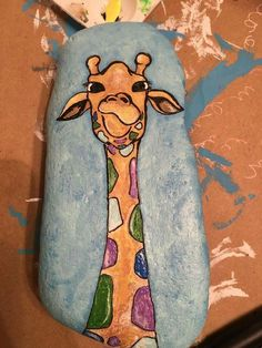 Giraffe painted rock