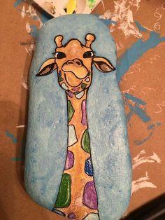 Giraffe painted rock