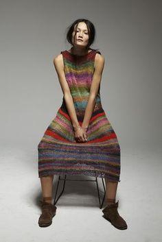 Rachel Rutt wears: hand-knitted dress (Rachel's own creation), vintage boots (Rachel's own), American Apparel socks, vintage bracelet from Akwa Avenue