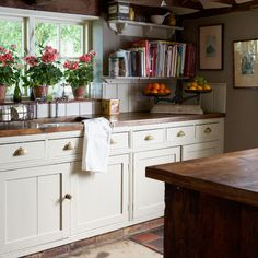 Shaker style lends itself to darker timber finishes  http://www.housetohome.co.uk/articles/Wooden_Shaker_style_396091.html#