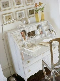 white and chrome painted writing bureau