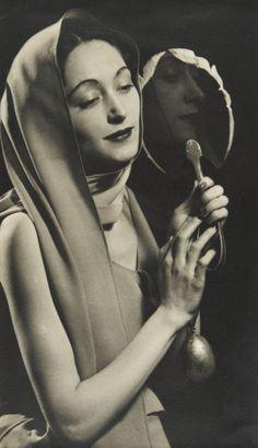Nusch Éluard wearing a sari-dress by Elsa Schiaparelli, photo Man Ray, 1935