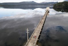 Pumphouse Point Hotel in Tasmania's Wilderness World Heritage Area. The hotel immerses its guests into a spectacular natural landscape. Accessible via a 900 feet-long jetty, the structure rises from Lake St Clair – Australia's deepest lake. Originally a facility that housed water turbines for a hydro-electric system, the Art Deco-inspired building dates back to 1940. Cumulus Studio transformed the industrial space into a comfortable and modern hotel. Serene and wild at the same time, the…