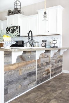 A quick and easy tutorial to get a rustic reclaimed look on a kitchen bar using real weathered wood from Stikwood without any nails required.