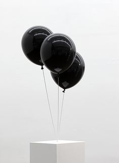 black balloons. [sculpture]