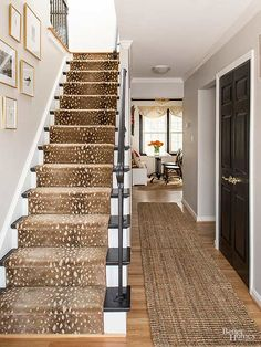 A faux deer-fur runner softens the black painted stairs with white risers. Coastal Living Rooms, Living Room Paint, Design Entrée, House Design, Black Painted Stairs, Black Stairs, Open Stairs, Loft Stairs, Suburban House