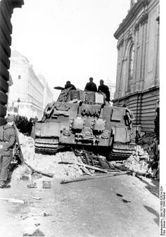 German Panzer VI (Tiger II) controlling a street in Budapest. October 1944
