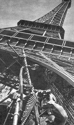 A Wehrmacht machine gunner at the Eiffel Tower - 1940