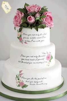 - Literary themed wedding. Cake handpainted with the couple's favourite quote from Elizabeth Barrett Browning. Cake topped with sugar roses and foliage.