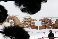 Two metal dragons were strung above Government Street on Saturday, another stage in the ongoing enhancement of Canada's oldest Chinatown. Steve Milroy hung his own artwork Saturday afternoon, . New Year Celebration, Lunar New, Chinese New Year, Dragons, Photograph, Pearl, Victoria, King, Times