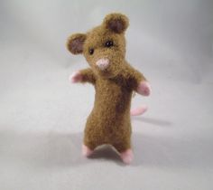 Handmade Needle Felted Mouse Fiber Sculpture. Meet Junior... a little needle felted brown mouse who wants to find a loving family who appreciates mice to call his very own!! He is made of sheep's wool over a wire armature, making him free-standing (he balances on his two little legs and his tail). He has black beaded eyes and has literally been stabbed into existence!! Please note... this is a made-to-order item... Your little mouse will be very similar to the one pictured here... Please...