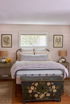 The Simpsons chose Farrow & Ball's Elephant's Breath for the walls of the guest room and covered a vintage iron bed in a diamond-pattern duvet from Pine Cone Hill.
