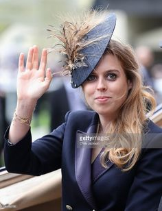 Princess Beatrice arrives in the parade ring at Royal Ascot 2016 at Ascot Racecourse on June 14, 2016 in Ascot, England. The cake hat was commissioned by bookmake Coral to celebrate the Queen's 90th Birthday.  (Photo by Chris Jackson/Getty Images)