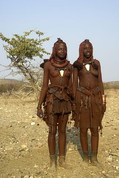 "Two Himba women wearing "" leopard cone "" shells (conus leopardus ) Southern Angola ."