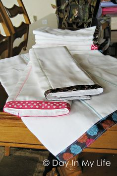Make burp clothes by sewing a ribbon on the end and adding stitching