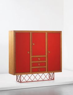 JEAN ROYÈRE Wardrobe, from Villa Matapao, Croissy sur Seine, circa 1947 Oak-veneered wood, oak, fabric, painted tubular metal. 63 1/8 x 66 7/8 x 18 3/8 in.