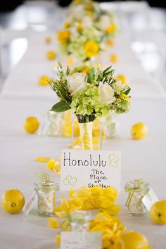 Give your summer wedding a taste of the season with a lemon and white table setting! {K & S Photography}