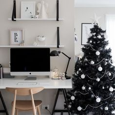 I have my beautiful traditional Christmas tree which I just love but I also have this black tree. Because monochrome!  #whitefoxstyling