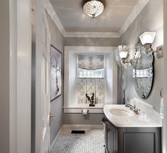 Wall paint color is Benjamin Moore HC 105 from the Historical Collection. Beautiful rich gray with hint of warmth. Makes this small powder room look amazing! #BenjaminMoore #GrayPaint