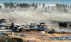 A massive tsunami sweeps in to engulf a residential area after a powerful earthquake in Natori, Miyagi Prefecture in northeastern Japan, on March 11, 2011.