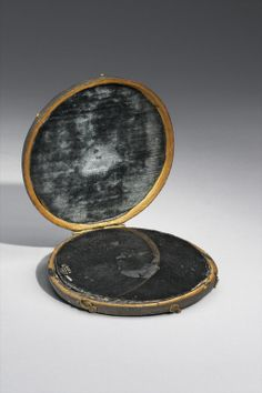 The High Priestess looks between the worlds Claude glass believed to be John Dee's scrying mirror, Europe, undated