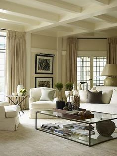 To add an elegant touch, take your curtains to the ceiling.