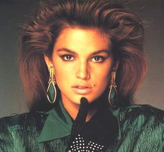 Cindy Crawford beauty mark (slight placement change) ~ makes her more attractive to a solid group of people (everywhere) ~ not raised at all