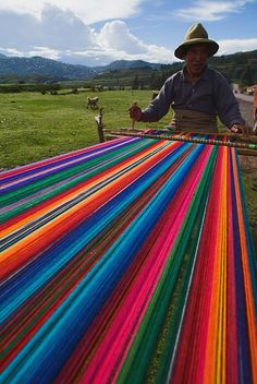 Weaver, Peru. Look at that rainbow of a warp!