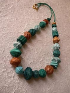 Corrugated cardboard beads. It looks like the board is painted first then rolled.