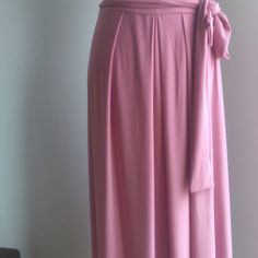 Pleated pink skirt with side tie Follow on Fb and instagram  nouf clothing