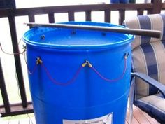 Homemade electrolytic rust removal device fashioned from a plastic drum, strips of flat bar, and a amp battery charger. Welding Jig, Welding Table Diy, Plastic Drums, Dowel Jig, Blacksmith Shop, Shops, How To Remove Rust, Homemade Tools, France
