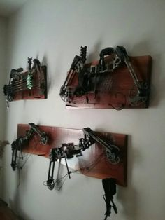 Compound bow racks made from roughsawn adirondack wood, dark, reddish finish, wooden hanging pegs drilled and doweled for bows.shipping charges will depend upon destination Deer Hunting Tips, Bow Hunting, Mens Hunting Clothes, Sling Bow, Bow Rack, Hunting Stands, Turkey Hunting, Crossbow, Planter Boxes