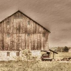 Imagine your home wall art that perfectly reflects your style. This rustic truck with the old weathered barn in the country is a sign of days gone by. This beautiful farmhouse decor print is great rustic home decor. Can you imagine how much this truck was used on the farm? #oldbarn #rustictruck #farmhousedecor #barnphotography
