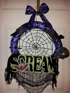 HALLOWEEN WREATH: Pool noodle, ribbon, wood sign, skull, and spiderweb. All picked up at dollar tree! Super fun, and easy Halloween project.