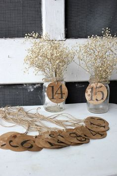 rustic woodland kraft paper wedding table numbers / http://www.deerpearlflowers.com/rustic-country-kraft-paper-wedding-ideas/