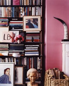 Pink wall color and black shelves ~ wonderful