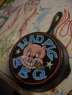 """One of a kind Garage Art """"mad pig bbq"""", hand painted in the good old US of A by Zander with one shot enamels on a vintage cast iron frying pan. Would look great in any Store, man cave or garage hangout. Art Fou, Garage Art, Pinstriping, Good Old, Hand Painted, Etsy, Vintage, Cave, Biker"""