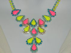 Painted rhinestone necklace colorful neon yellow pink and light mint blue, via Etsy.