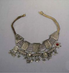 Yemen - Necklace - silver, translucent  glass cabochons (all but one remains), strung on cotton cord |
