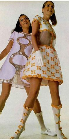 Mini dresses with clear vinyl sections and boots by Andre Courreges.