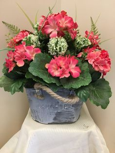 Cheer someone up with this cute tin! All around artificial flower arrangement in laughter tin with rope handles. Coral and cream flowers. Artificial Floral Arrangements, Silk Arrangements, Artificial Flowers, Coral Wedding Flowers, Flower Bouquet Wedding, Cream Flowers, Silk Flowers, Wedding Centerpieces, Bowl Centerpieces