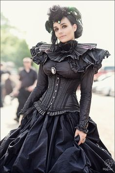 Somewhere at the intersection of goth, steampunk and rococo punk.